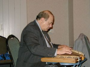 Jack Chalikian playing kanun at Kef Tim Hartford in 2003.