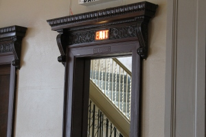 This exit is to the left of the stage. The stairs go up to the church area.