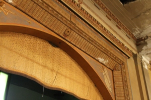A closer look at the craftsmanship of the molding on the stage.
