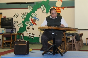 Playing music for Aline's school.