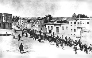 Armenian men, women and children marching to their death, led by Turkish soldiers in 1915.